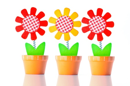 value add: wooden flower on bright background