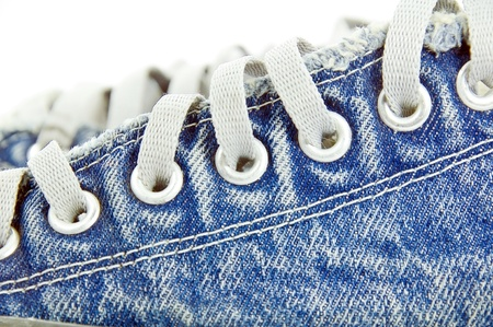 old jean canvas shoes  on the background  Stock Photo - 14493527