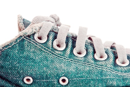 unravel: old jean canvas shoes  on the background