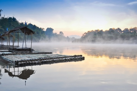 riverside tree: floating house and fog in the morning ,Kwae Noi river  ,Kanchanaburi,Thailand