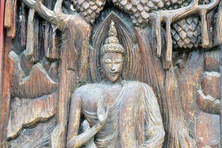woodcarving background  on the door of thai temple Sa Kamphaeng Yai temple, thailand photo