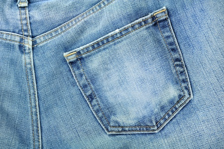 grabbing at the back: texture of jeans clothing