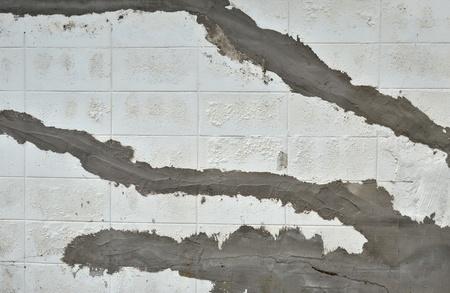 facing a wall: facing on the old wall, wall maintenance  Stock Photo