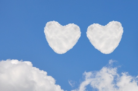 wedlock: heart cloud   on blue sky background Stock Photo