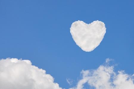 heart cloud   on blue sky background photo