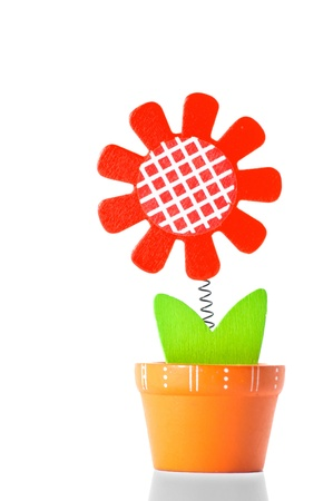 value add: wooden flower on white background
