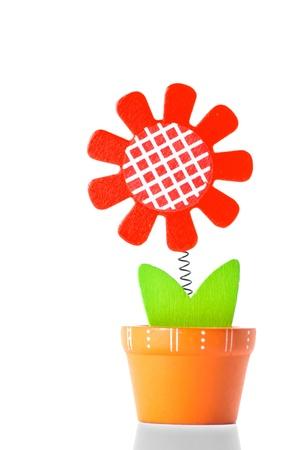 gewgaw: wooden flower on white background