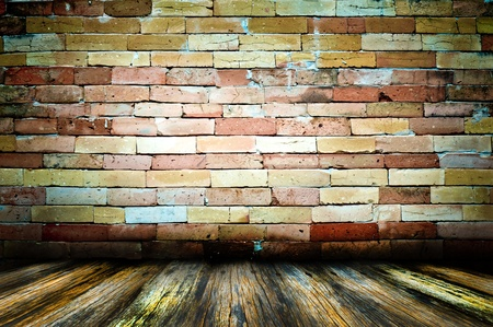 Empty old spacious room with stone grungy wall weathered dirty floor, vintage background texture of brickwall photo