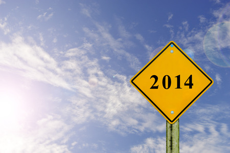 Road sign to 2014 with blue sky background,happy new year 2014