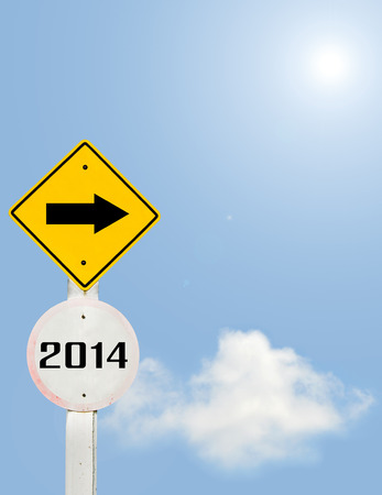 Road sign to 2014 with blue sky background,happy new year 2014 photo