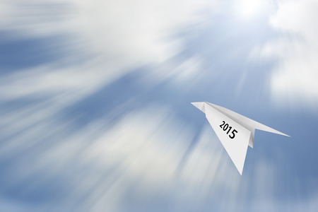 Paper plane on blue sky background with happy new year 2015  concept photo