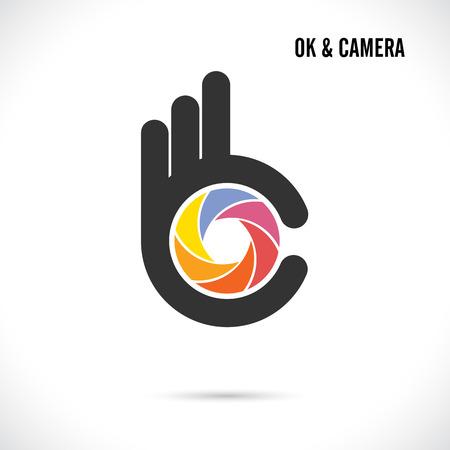 ok hand symbol: Creative hand and camera lens abstract logo design.Hand Ok symbol icon.Corporate business creative logotype symbol.Vector illustration