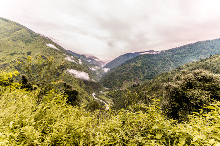 Photo of Tropical mountain range view. Timelapse Of Moving Clouds And Fog over Himalayan mountain range in Sainj, Kullu, Himachal, India 写真素材