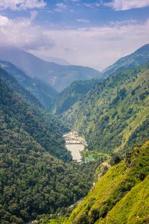 Photo of mountain range view. Timelapse Of Moving Clouds And Fog over Himalayan mountain range in Sainj, Kullu, Himachal, India