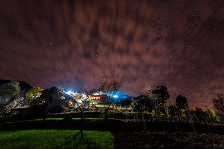Night view of Village in Himalayas in India - Stock Photo