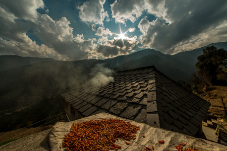 Traditional house and red chilies in himalayas - India