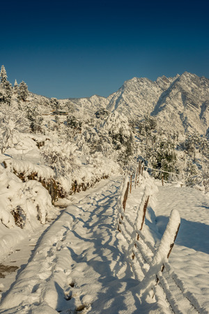 Snow covered road in mountains - Majestic winter landscape in himalayas - India