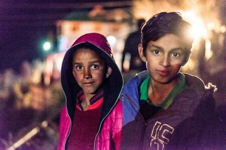 Kullu, Himachal Pradesh, India - December 07, 2018 : Portrait of local boys in himalayas