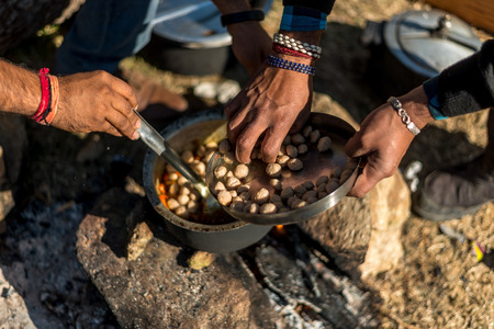 Cooking mix veg using firewood is an survival skill needed when going to the wilderness or outdoor activity in himalayas Фото со стока