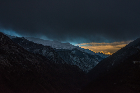 sunset view from mountaintop in himalayas in india -