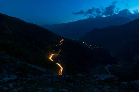 Photo of Traffic trails on rohtang pass at night. Crossing mountains in India