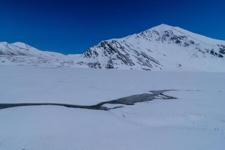 River in the mountains covered with snow. Winter landscape. The concept of freedom and movement
