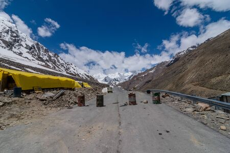 obstacles in road with blue sky in ladakh in winters