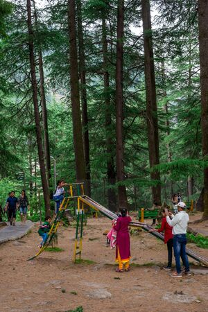 Manali, Himachal Pradesh, India - May 07, 2019 : Photo of Tourist enjoying in van vihar national park in himalayas Zdjęcie Seryjne - 137979577