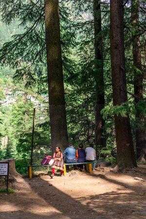 Manali, Himachal Pradesh, India - May 07, 2019 : Photo of Tourist enjoying in van vihar national park in himalayas Zdjęcie Seryjne - 137979615