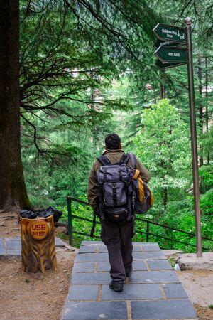 Manali, Himachal Pradesh, India - May 07, 2019 : backpacker in van vihar national park in himalayas -