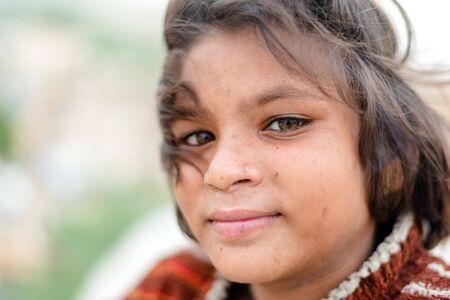 Jaisalmer, Rajasthan, India - July 29, 2019 : Portrait of Girl in Thar Desert -