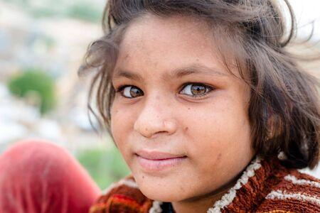 Jaisalmer, Rajasthan, India - July 29, 2019 : Local Girl Portrait in Thar Desert -