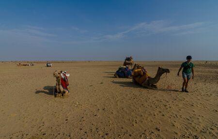 Jaisalmer, Rajasthan, India - July 29, 2019 : Tourist with camel in Thar desert - Editöryel