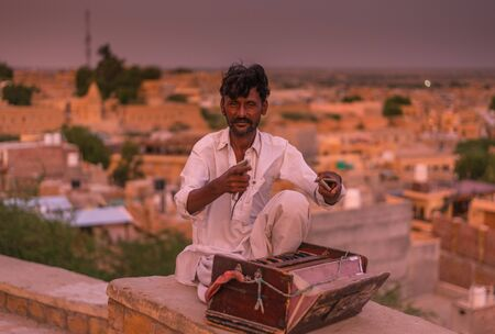 Jaisalmer, Rajasthan, India - July 29, 2019 : Indian musicians in traditional dress playing musical instruments -