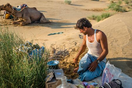 Jaisalmer, Rajasthan, India - July 29, 2019 : Local Man Cooking in Thar Desert - Editöryel