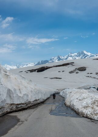 Empty Road at Snow Covered Rohtang pass in June - 写真素材
