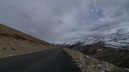 Photo of Road in mountains Himalayas and dramatic clouds. Ladakh, Jammu and Kashmir, India 写真素材