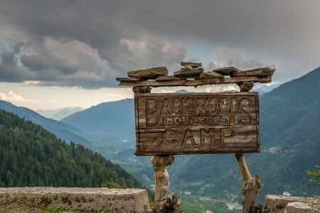 Old wooden house signboard in manali in himalayas -