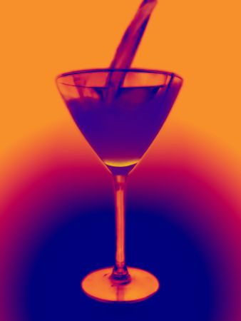 violett martini glass with cocktail, orange & violett background                photo