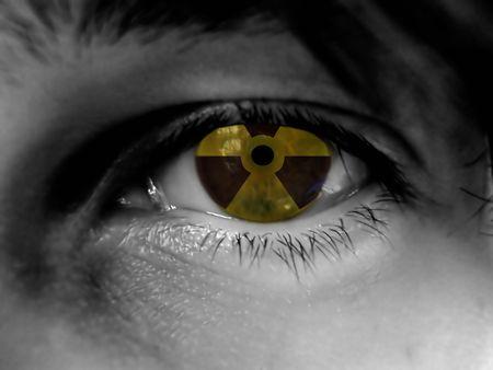 gamma radiation: black and white part of face, radiation warning reflection in eye Stock Photo