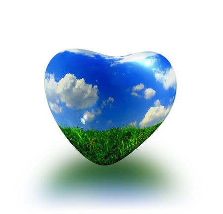 plastic heart: abstract picture about heart with blue sky, white clouds and green grass