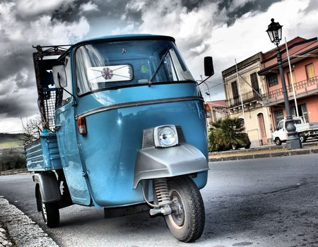 This is a photo of blue retro car in hdr photo
