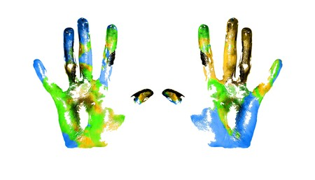 Handprints with imitation of Earth on white background photo
