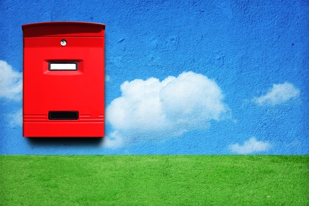 red mail box on the wall with landscape Stock Photo