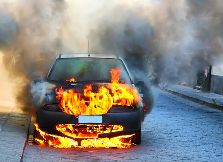 fire car: a car on fire