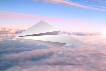 Paper airplane in the sky photo