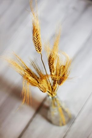 Photo of wheat on wooden background Stock Photo - 17341512