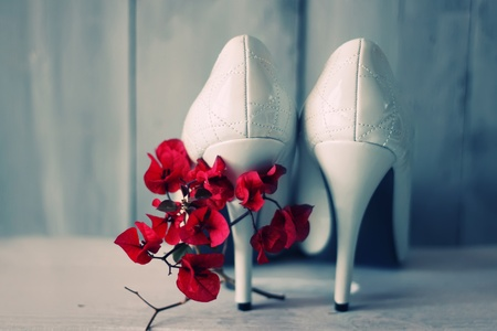 wedding accessories: Photo of white shoes and flowers Stock Photo