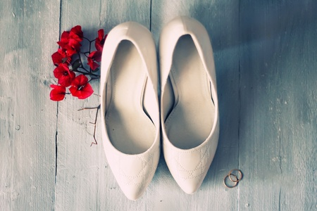 Photo of white shoes and flowers Stock Photo