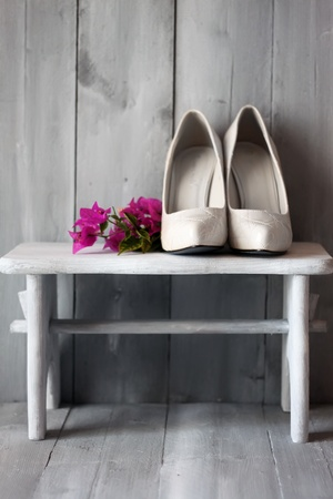 sexy bride: Photo of white shoes and flowers Stock Photo
